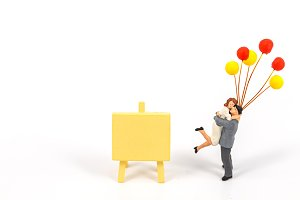 MIniature couple on white background