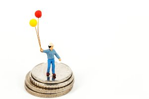 miniature man hold balloon
