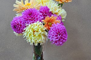 glass vase with dahlias