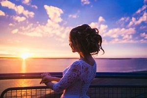 Romantic bride in magenta sunset