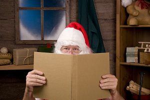 Santa Claus in Workshop With Book