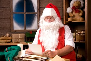 Santa Claus in Workshop With Bag of