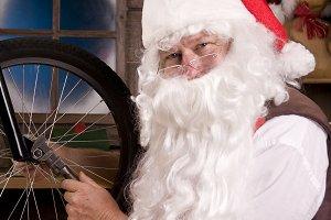 Santa Assembling Bicycle in Workshop