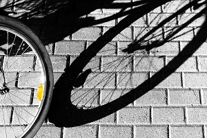 The shadow of a bicycle wheel