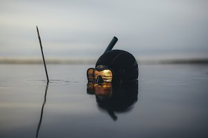 Spearfishing diver with reflection