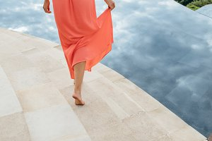 Woman in orange sundress