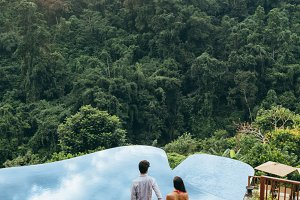 Young couple walking towards pool