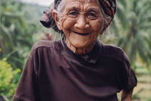 Old woman standing outdoors