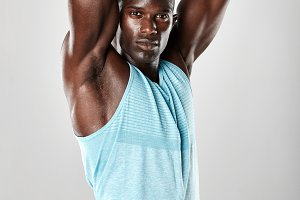 Muscular young man stretching