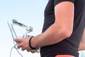 Man with drone controller in hands#4