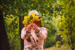 Woman holding leaves ahead