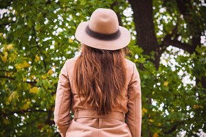 Woman in coat with hat from behind