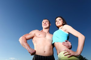 athletic man and woman standing