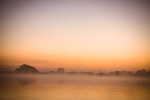 Morning foggy over the water