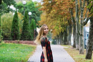 girl in dress in autumn park