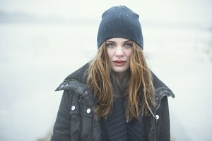 blue-eyed girl in the snow