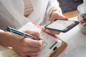 Woman writes to her diary