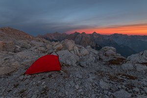 Tent in the mountains at sunset