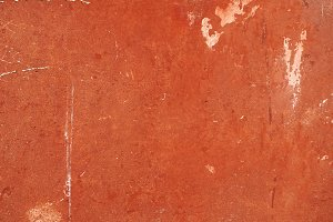 Red plaster wall background