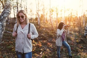 Two young women forest hiking