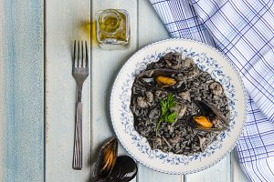 Black risotto plate with seafood.