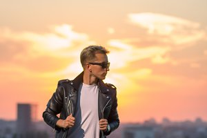 sunset young man leather jacket
