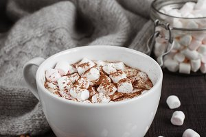 The cup of beverage with marshmallow