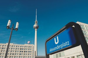 TV tower at Alexanderplatz in Berlin with subway sign in front.