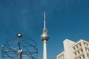TV tower at Alexanderplatz in Berlin with world clock and building.