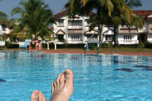 male foots near the swimming pool