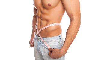 Model measuring his waist