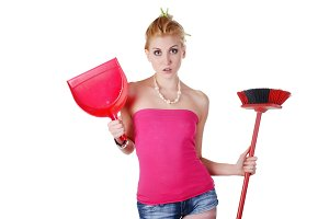housewife with dustpan and broom