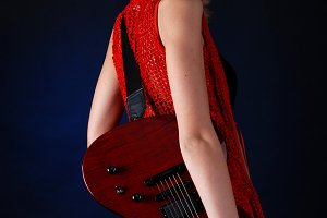 woman with red electric guitar