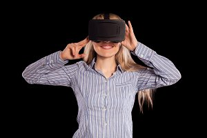 Woman in virtual reality helmet