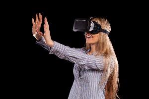 Woman in virtual reality helmet