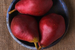 Three Red Pears on Blue Plate