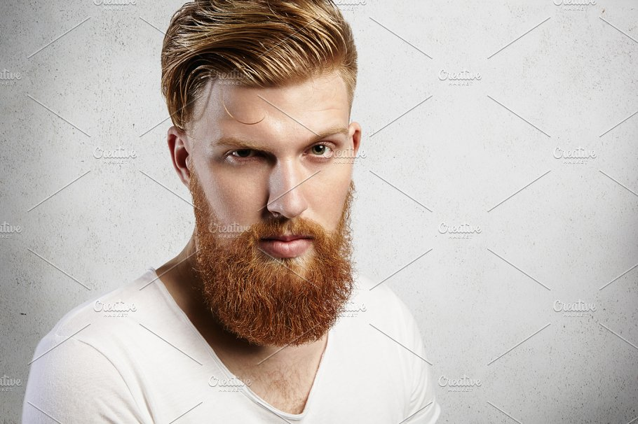 Closeup Portrait Of Young Caucasian Man With Long Ginger Beard - Ethiopian hipster hairstyle