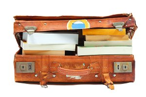 Open suitcase stuffed with books only