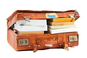 Open suitcase stuffed with books