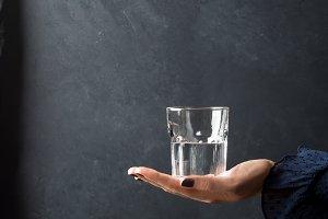 Glass of water on dark background