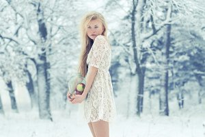 skinny girl in winter forest