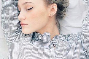 feminine woman asleep in bed