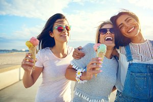 Laughing teenage girls enjoying ice cream cones