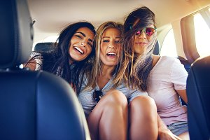 Three happy young women traveling on vacation