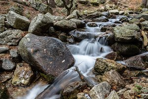 Water Stream Flowing in the Mountain