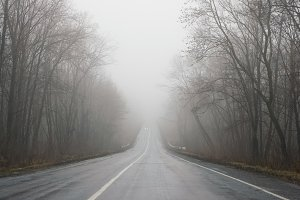 foggy straight roade in Ukraine
