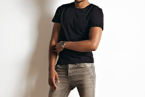 Fashion photo of a handsome man in black t-shirt