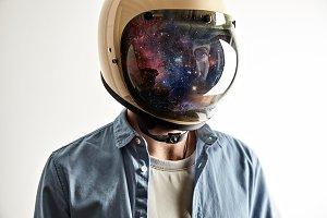 Man in helmet with starry sky on shield