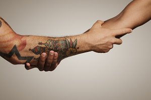 Close up shot of a forearm handshake
