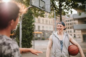 Happy young streetball players